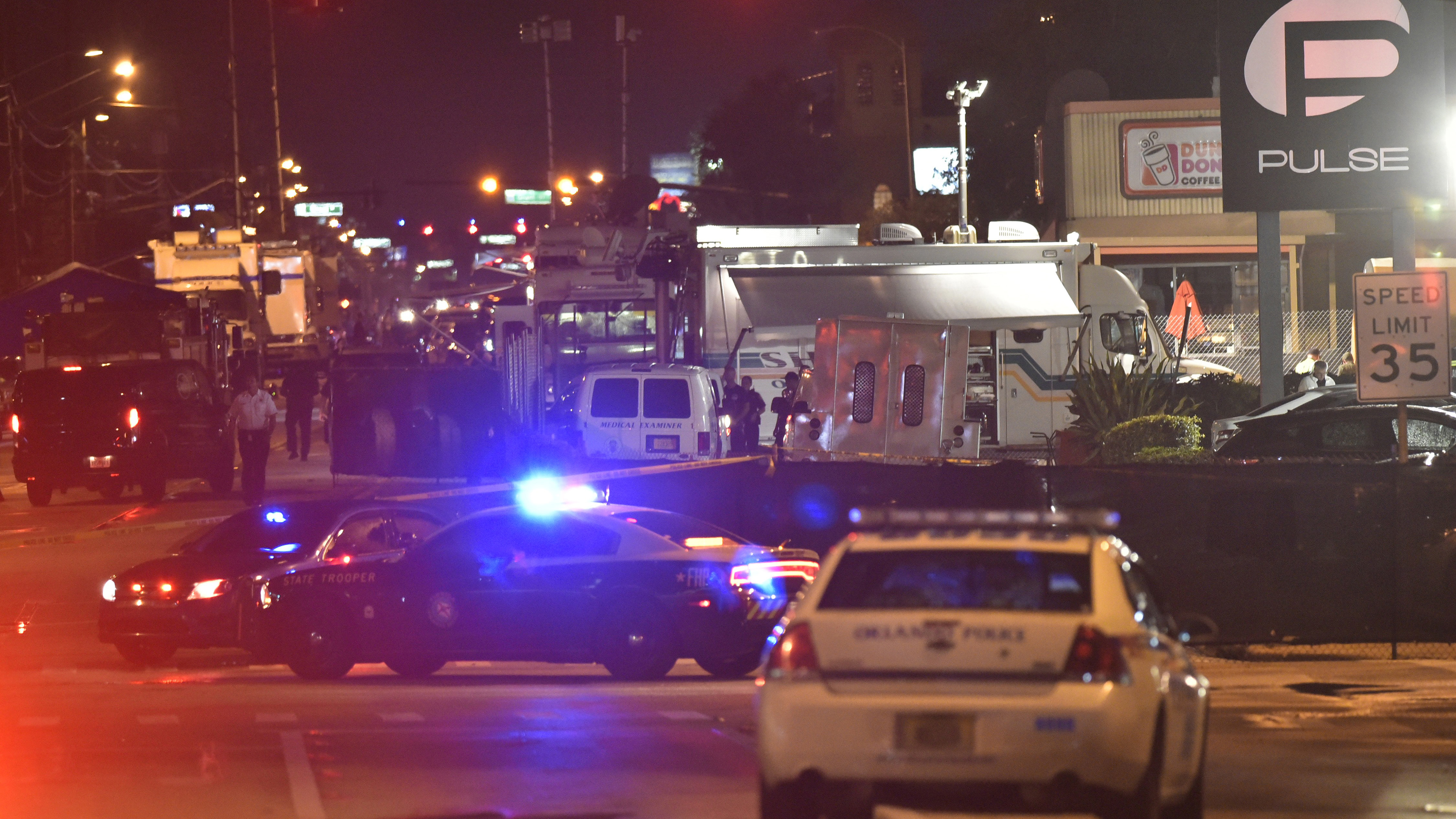 Lights from police vehicles light up the scene in front of the Pulse club in Orlando, Florida after a fatal shooting on June 12, 2016. GETTY IMAGES/AFP/Mandel Ngan