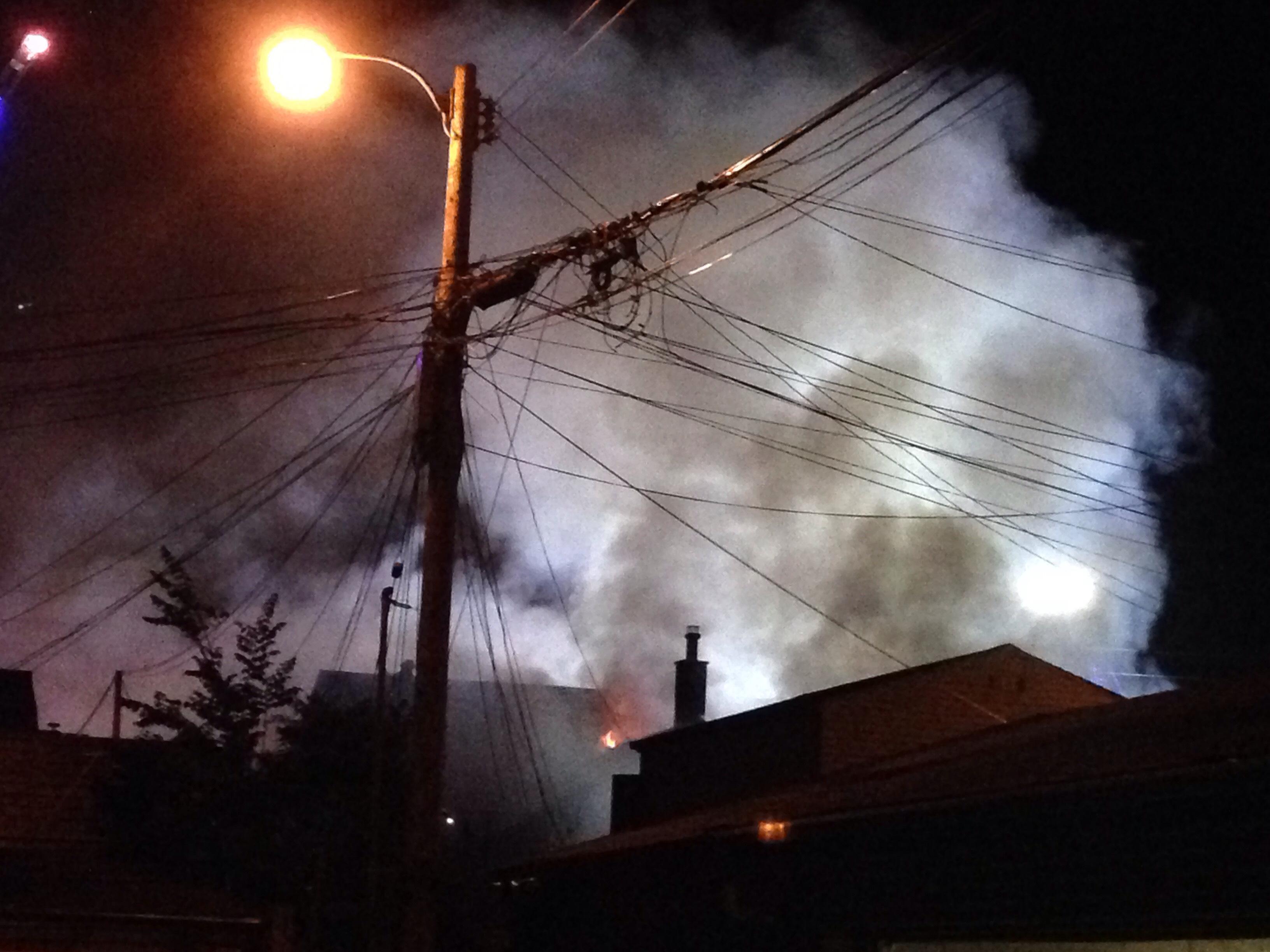 A five-alarm fire burns on Dundas Street west of Bathurst Street on June 30, 2016. CITYNEWS/Hugues Cormier