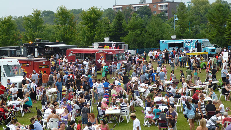 People hanging out at the Toronto Food Truck Festival. Photo via torontofoodtruckfestival.com.