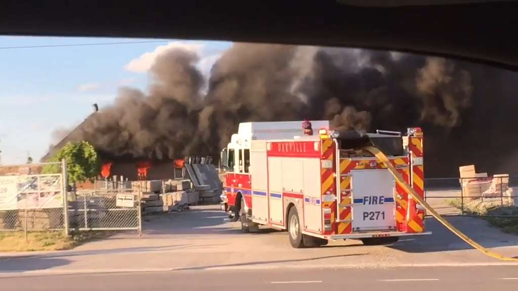 Video: Crews work to extinguish large fire in Oakville