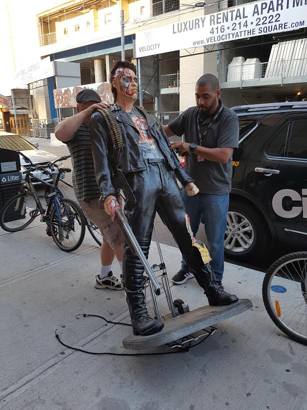 Cameraman Bert Dandy, who found the Terminator prop, and assignment editor Louay El-Khatib roll the prop into the CityNews building on Aug. 4, 2016. CITYNEWS/Diana Pereira