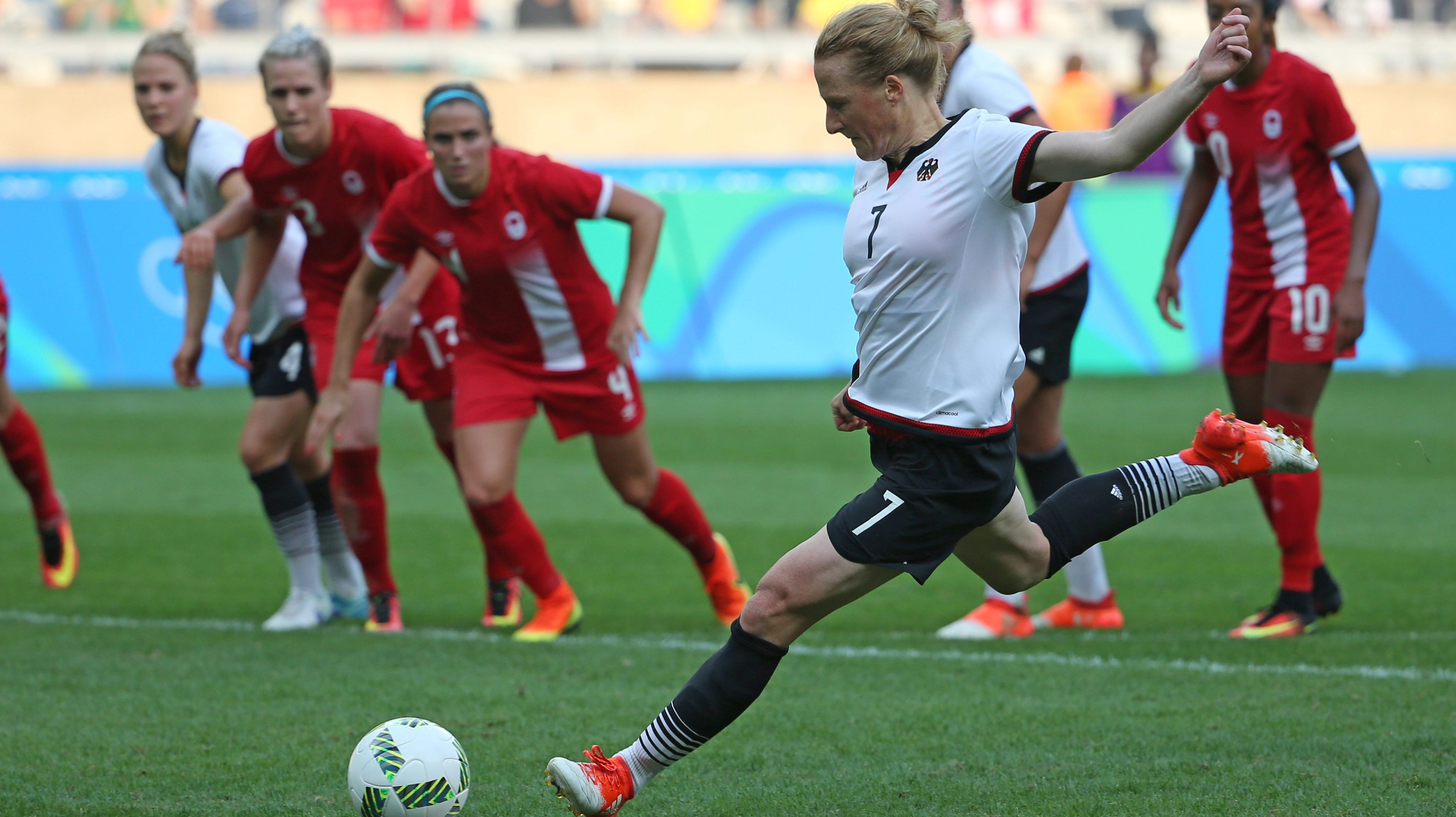 Germany's Melanie Behringer scores from the penalty spot during a semi-final match of the women's Olympic football tournament between Canada and Germany at the Mineirao stadium in Belo Horizonte, Brazil, on Aug. 16, 2016. THE ASSOCIATED PRESS/Eugenio Savio