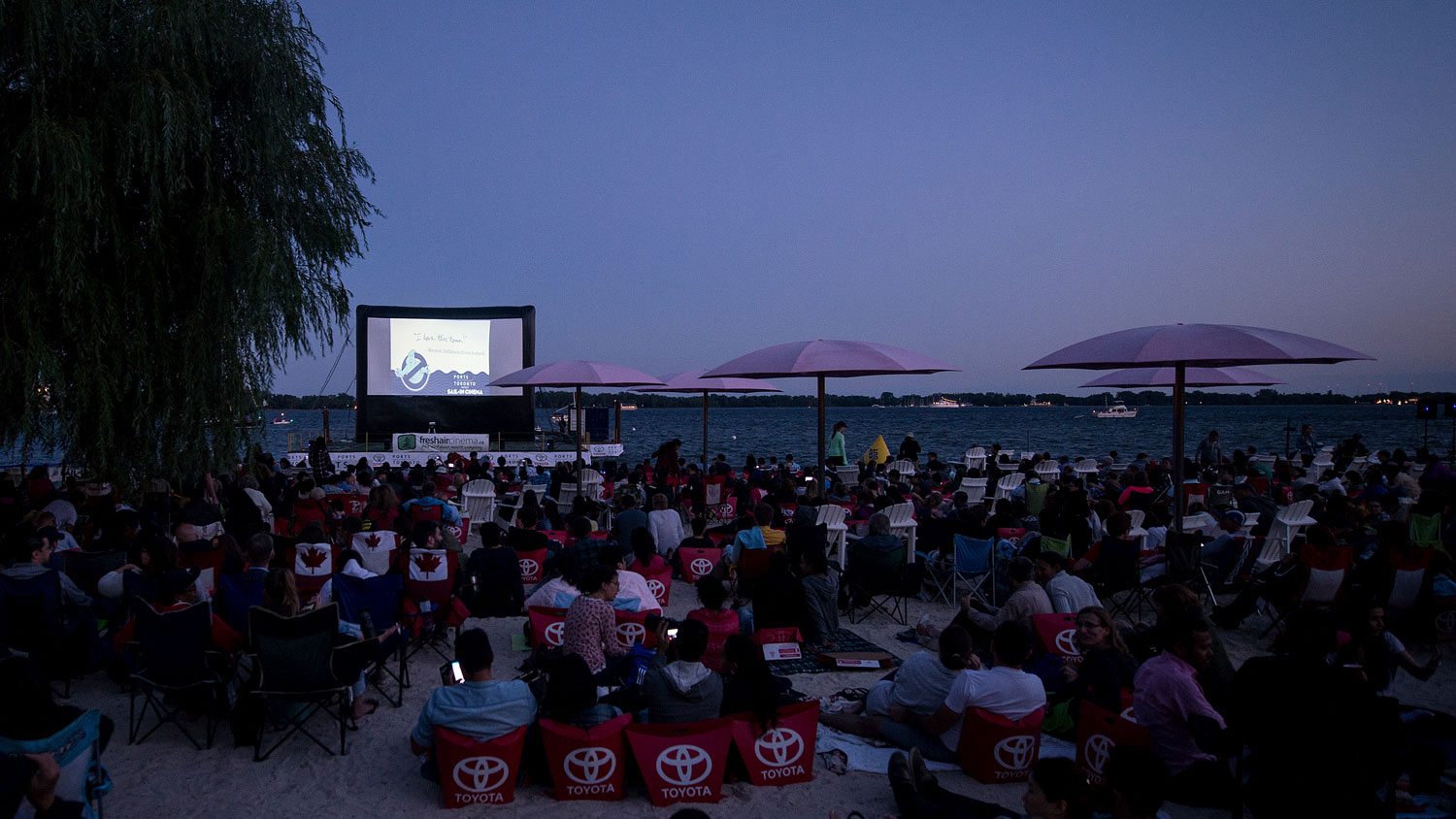 People gather at Sugar Beach to watch movies at the Sail-in Cinema in 2015. Photo credit: Ports Toronto