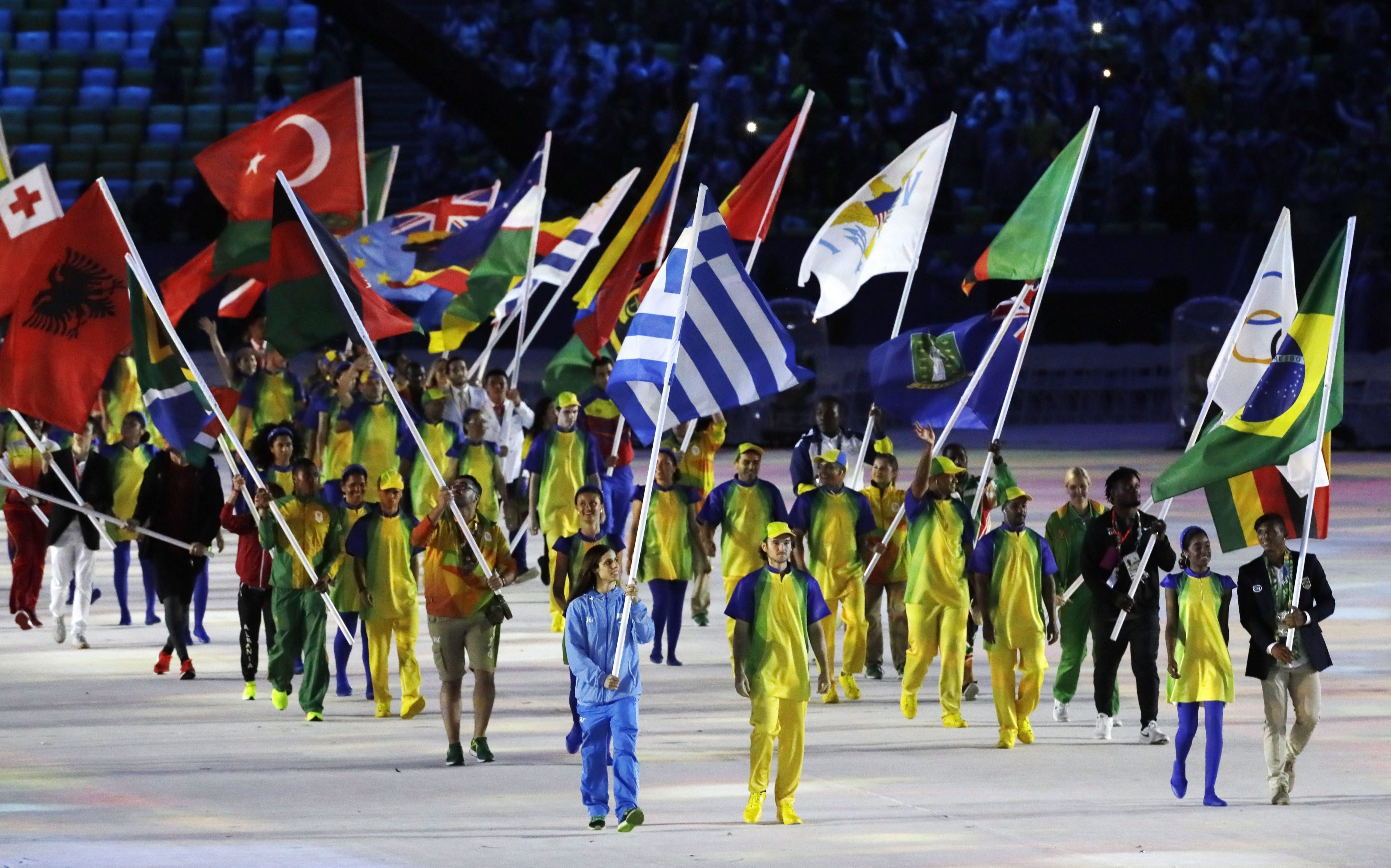 Flags are carried into the closing ceremony in the Maracana stadium at the 2016 Summer Olympics in Rio de Janeiro, Brazil, Sunday, Aug. 21, 2016. (AP Photo/Mark Humphrey)