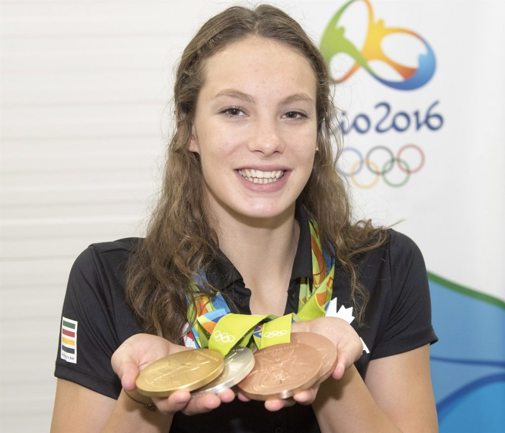 Canada's Penny Oleksiak, from Toronto, holds up her four medals, a gold, silver and two bronze, she won at the 2016 Summer Olympics during a news conference Sunday, August 14, 2016 in Rio de Janeiro, Brazil. Oleksiak will carry the Canadian flag into Maracana Stadium for tonight's Olympic closing ceremony.THE CANADIAN PRESS/Ryan Remiorz