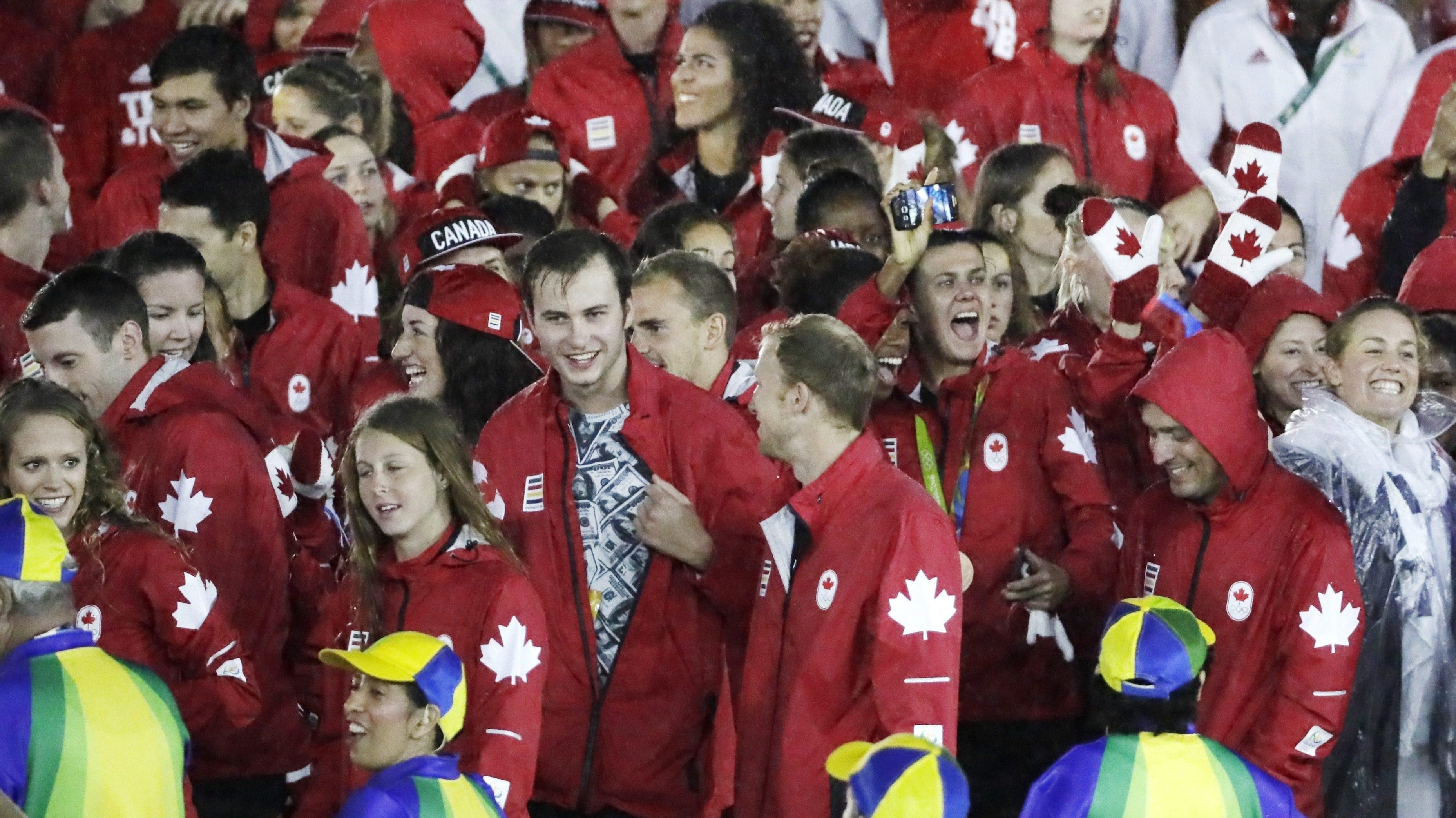 Canadian athletes celebrate during the closing ceremony in the Maracana stadium at the 2016 Summer Olympics in Rio de Janeiro, Brazil, Sunday, Aug. 21, 2016. (AP Photo/Mark Humphrey)