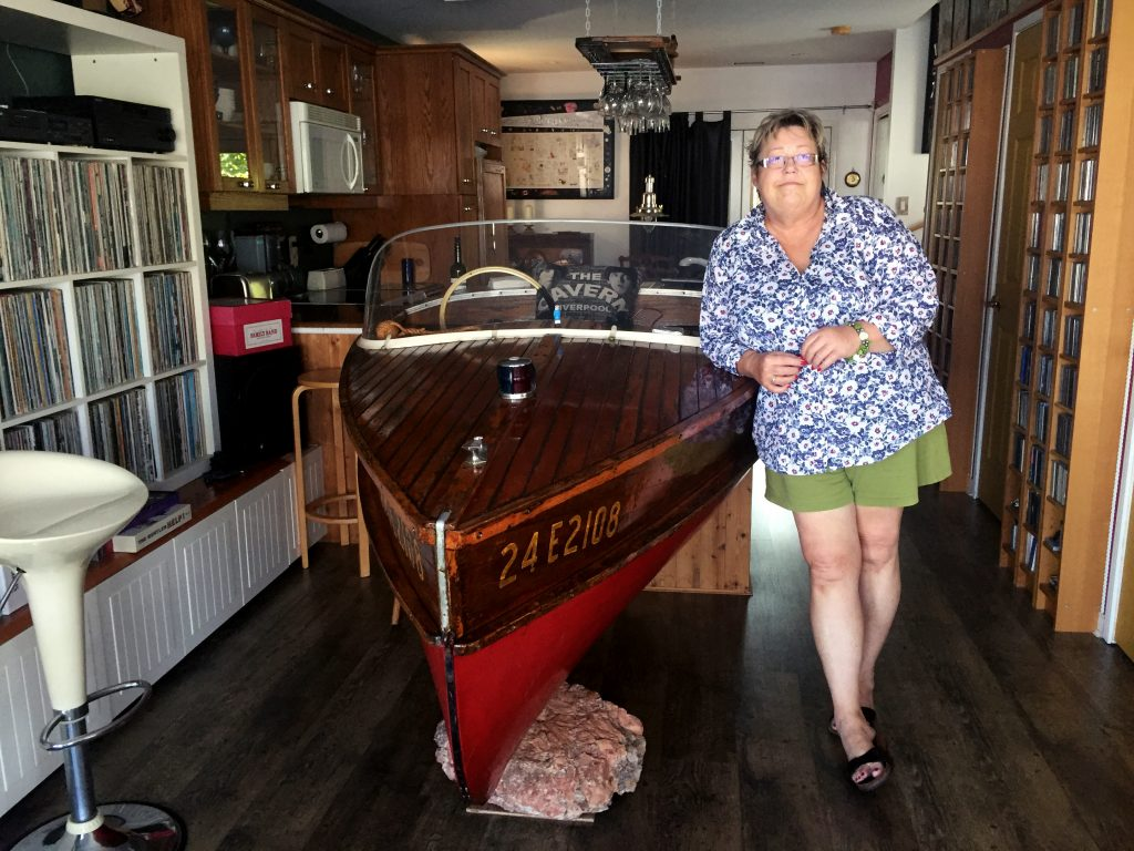 Penny Barr stands in her float boat home located at Bluffer's Park Marina. CITYNEWS/Adrian Ghobrial