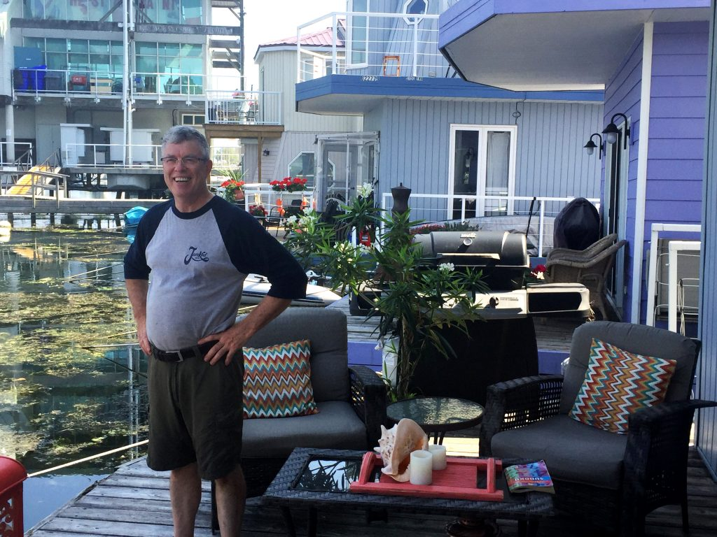 Roy Cronnis on his deck of his float home. CITYNEWS/Adrian Ghobrial