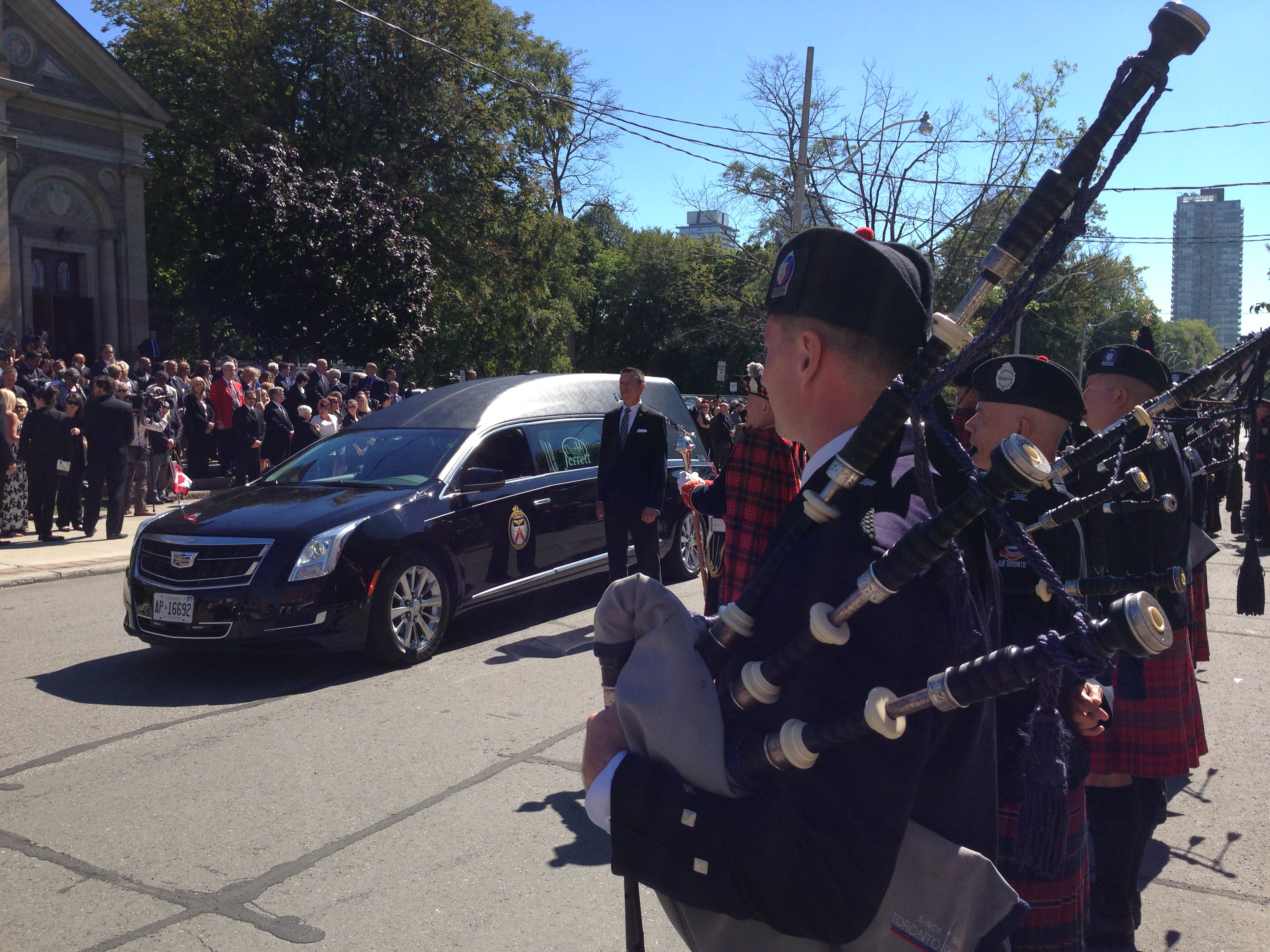 The funeral cortege for William 'Bill' McCormack arrived at St. Paul's Basilica, on Power Street near Queen and Parliament streets, on Sept. 12, 2016. CITYNEWS/Stephen Boorne
