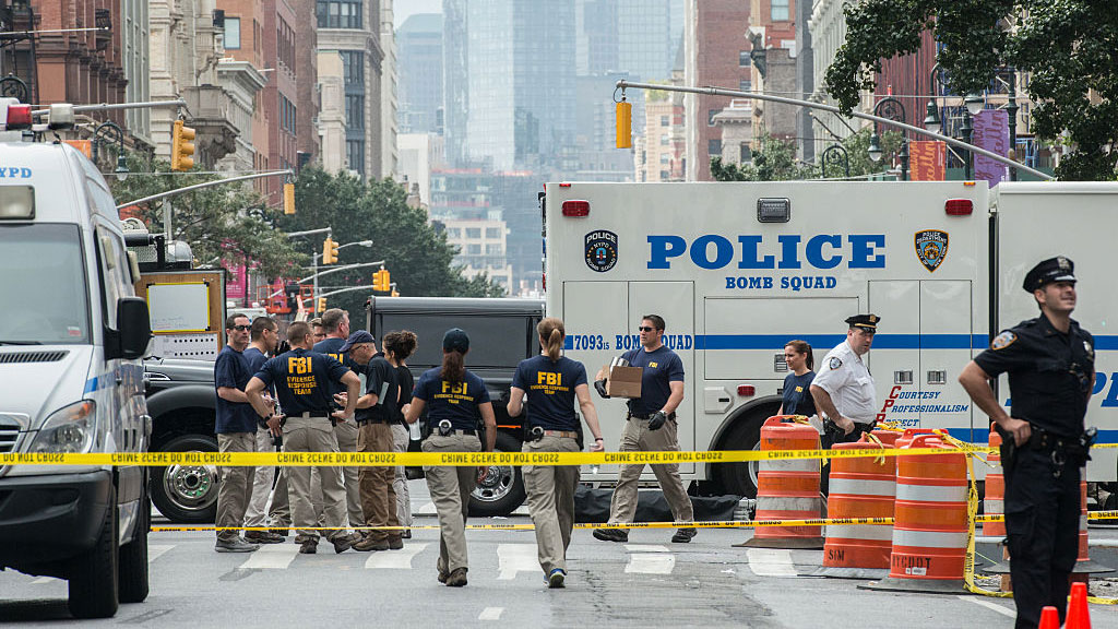 FBI agents review the crime scene of remnants of bomb debris on 23rd St. in Manhattan's Chelsea neighborhood in New York City on Sept. 18, 2016. GETTY IMAGES/Stephanie Keith
