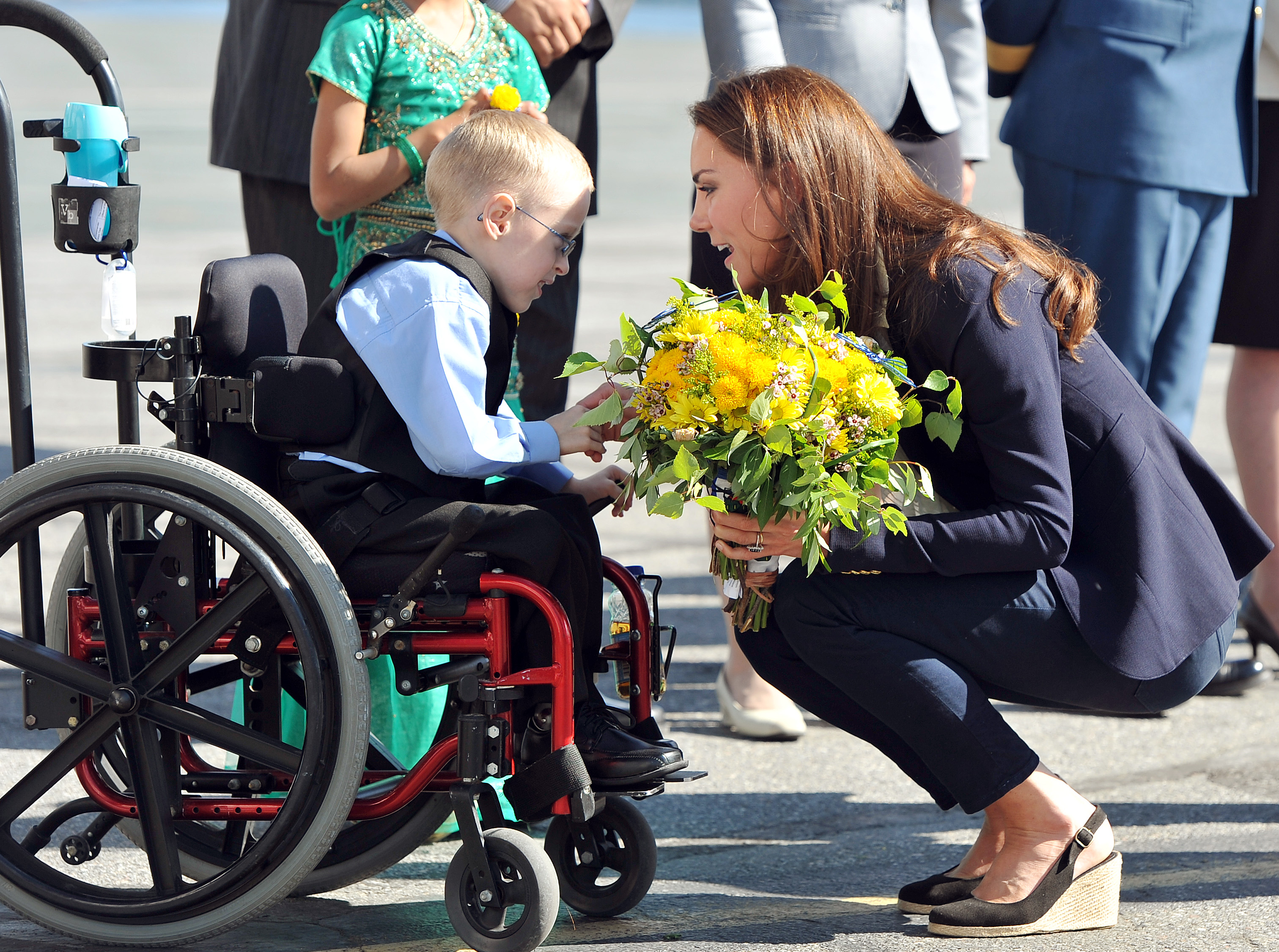 Catherine, Duchess of Cambridge wears a Smythe blazer while talking to Riley Oldford, 6, at Yellowknife Airport on July 6, 2011. GETTY IMAGES/POOL/John Stillwell