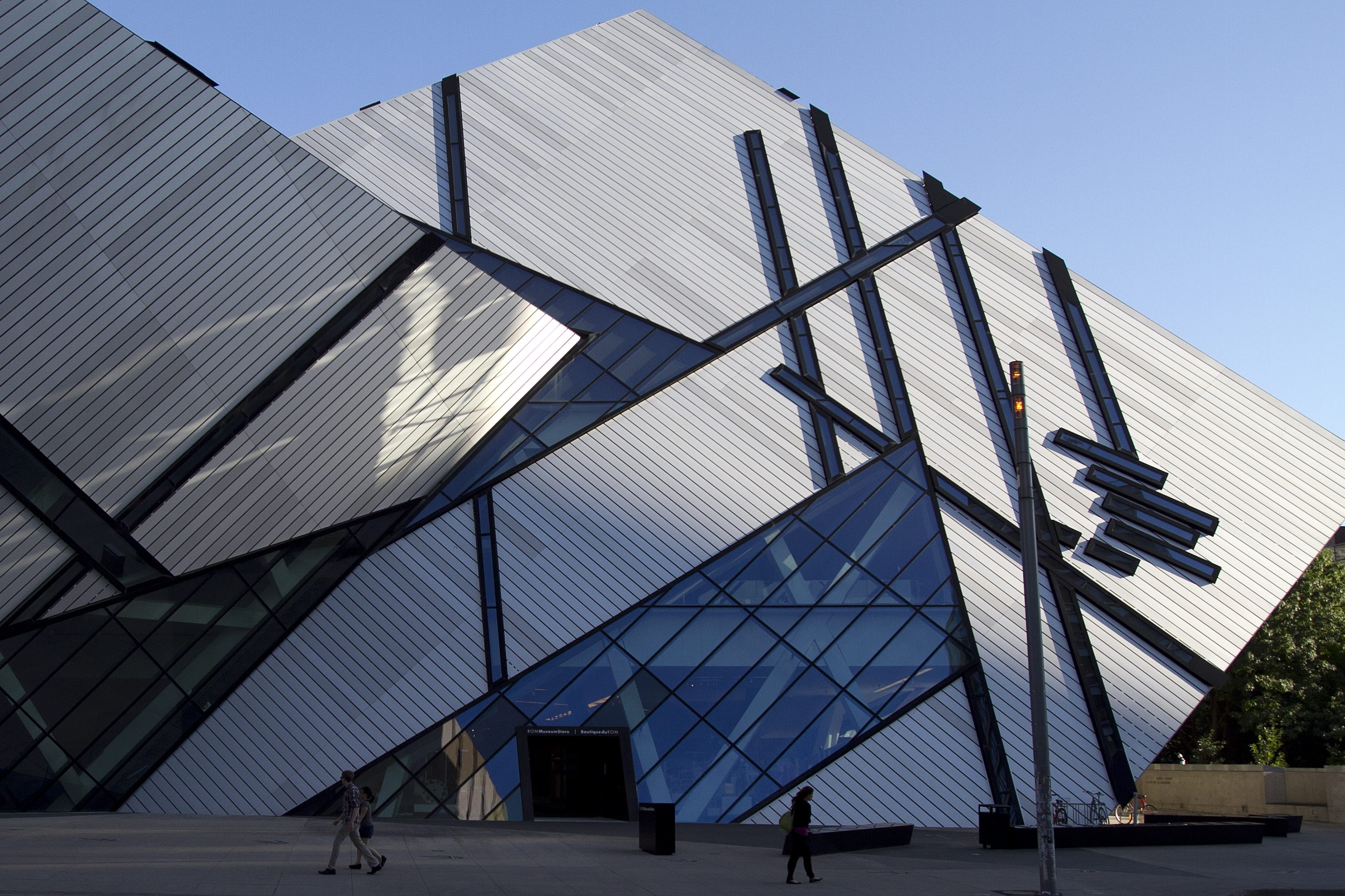 People walk in front of the Royal Ontario Museum on Aug. 7, 2012. THE CANADIAN PRESS/Lars Hagberg