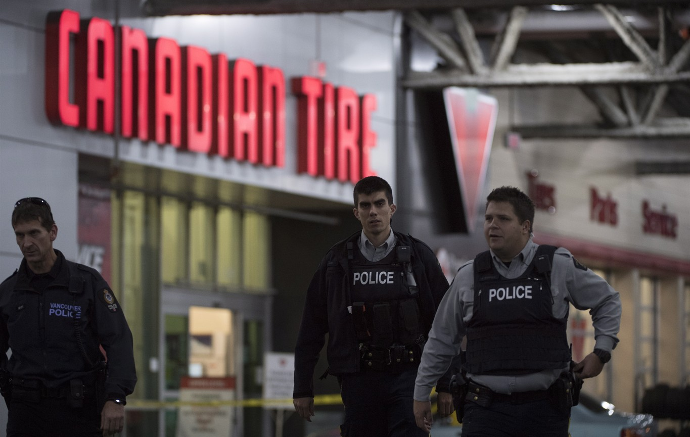 vancouver robbery suspect killed officer store worker stabbed police are seen outside a canadian tire store in vancouver b c thursday nov 10 2016 vancouver police responded to what they called a serious