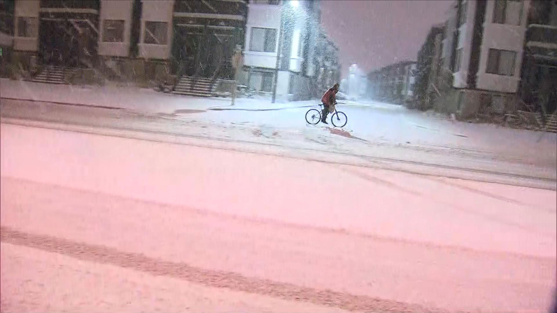 A cyclist rides their bike during a snowfall in the Richmond Hill area on Dec. 5, 2016. CITYNEWS/Bertram Dandy