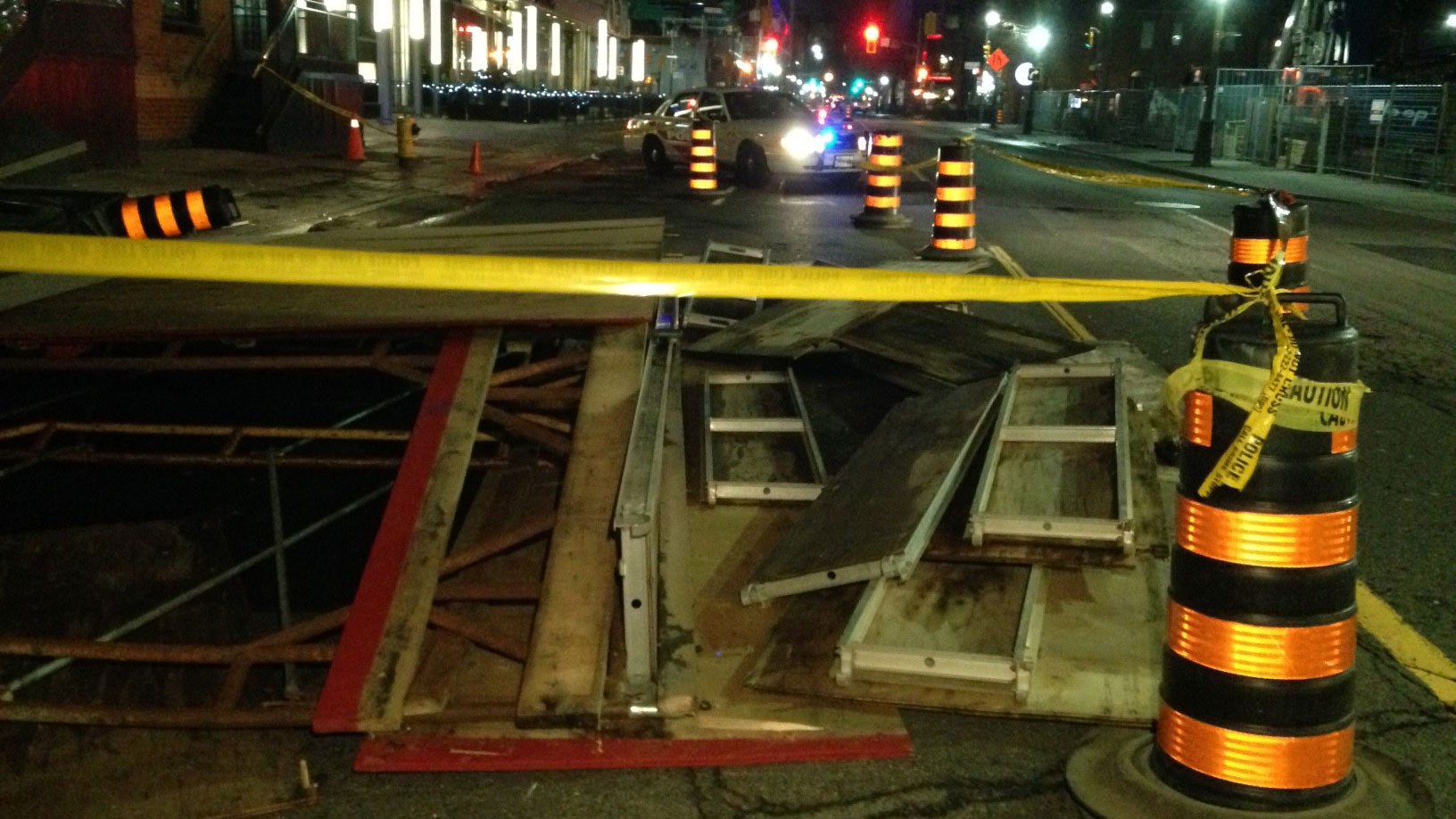 Construction material collapses at King and John streets scattering debris on the roadway and sidewalk on Jan. 11, 2017. CITYNEWS/Bertram Dandy
