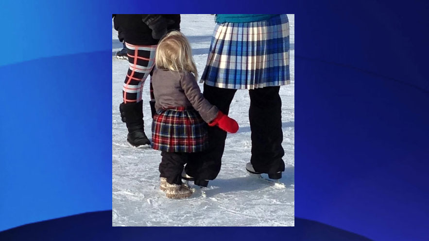 A child stands next o her parent at the Sir John A's Great Canadian Kilt Skate. Photo via kiltskate.com.