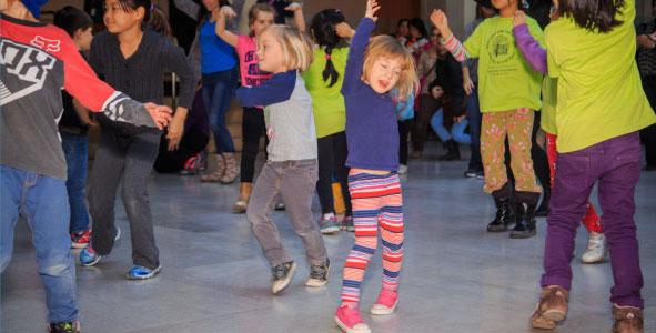 Children dancing at the Art Gallery of Ontario. AGO