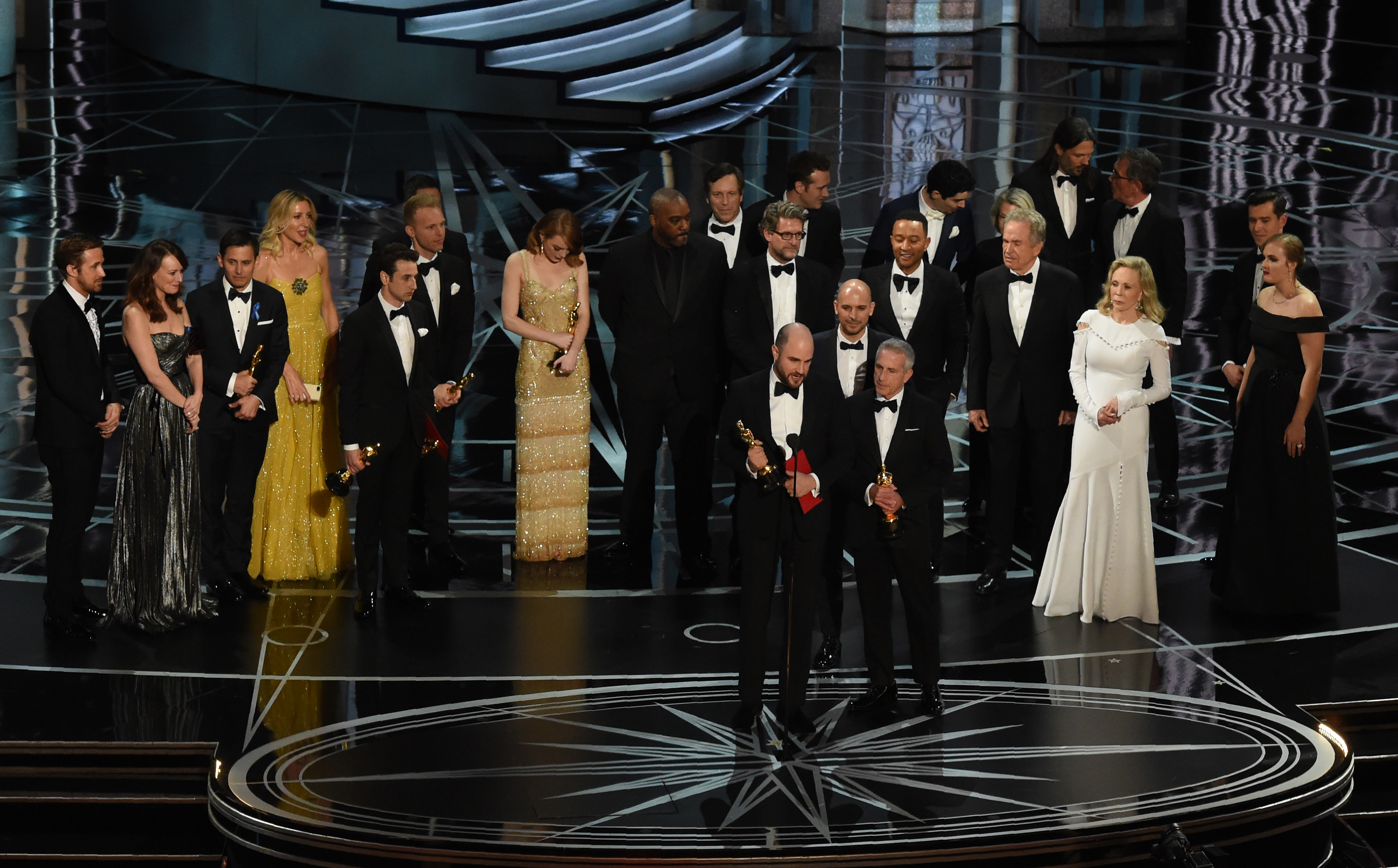 'La La Land' producer Jordan Horowitz (C) speaks while holing an Oscar and the winner card before reading the actual Best Picture winner 'Moonlight' onstage during the 89th Oscars on Feb. 26, 2017 in Hollywood, California. GETTY IMAGES/AFP/Mark Ralston