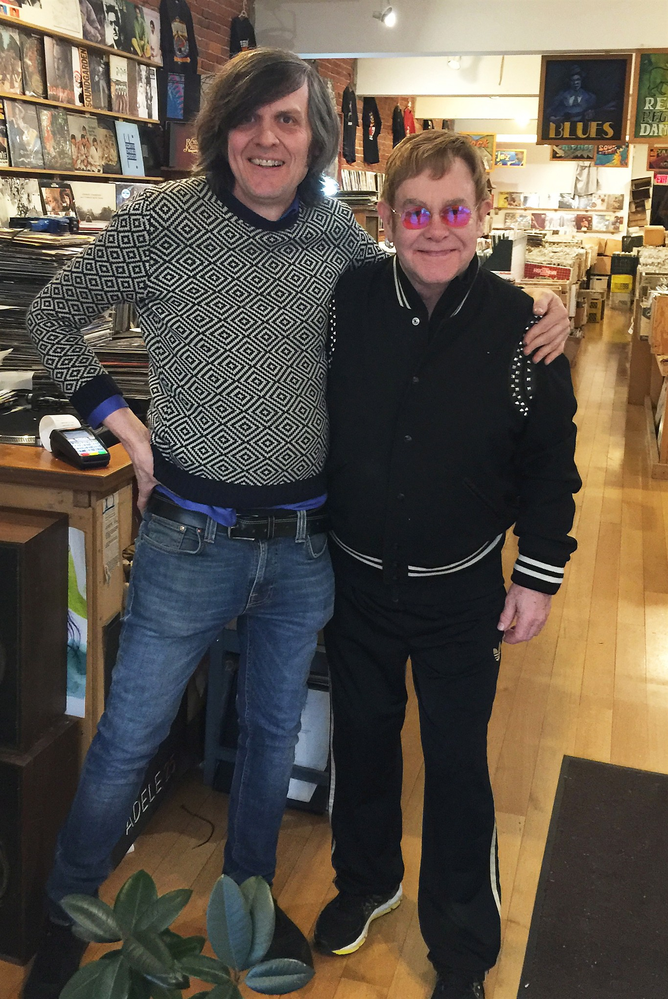 Elton John pops into a Vancouver record store to pick up some vinyl