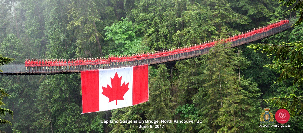 BC RCMP standing shoulder-to-shoulder as part of Canada 150 birthday salute (BC RCMP / Facebook)
