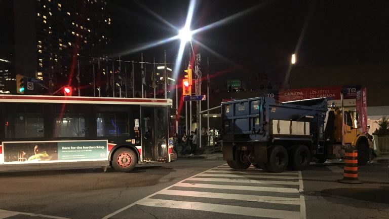 A TTC bus and a garbage truck block the crowds at Nathan Phillips Square, forming a 'safety perimeter' during Canada 150 celebrations. CITYNEWS