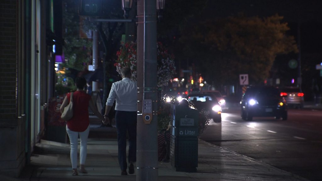 A couple walks in the dark along Bloor in The Kingsway, Aug. 10, 2017. CITYNEWS