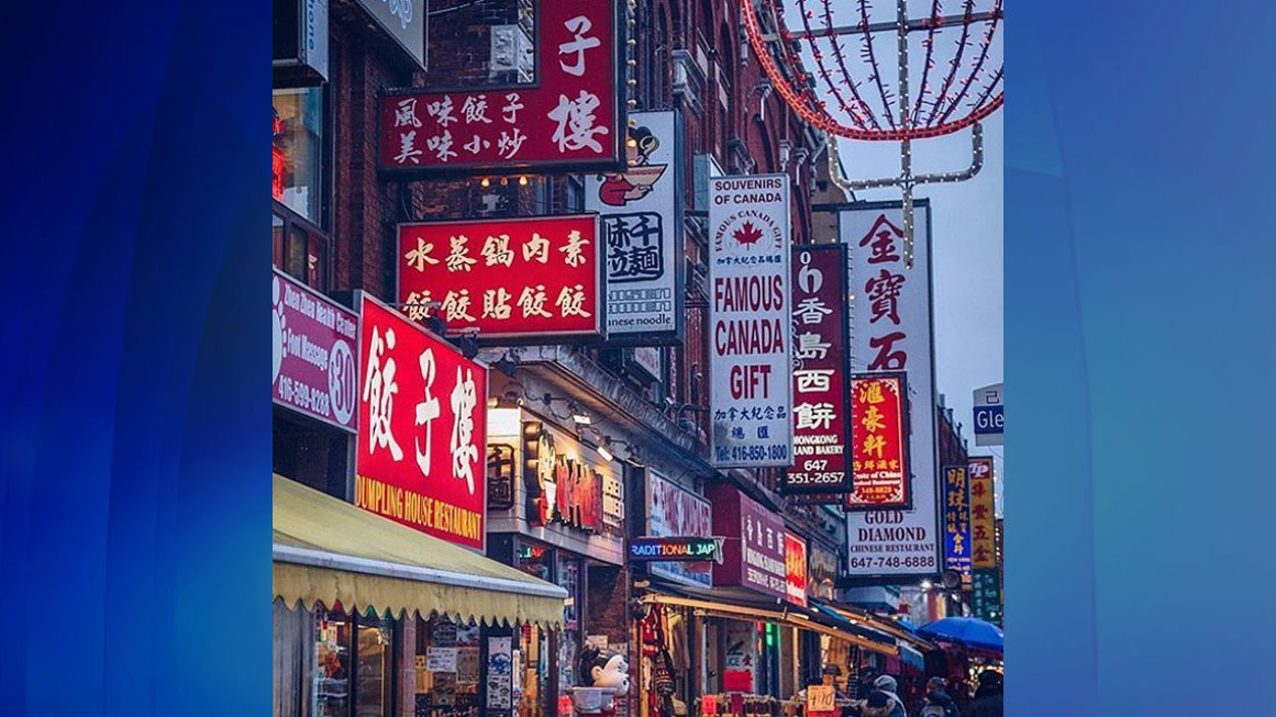 Chinatown in Toronto at dusk. Photo credit: Instagram/torontochinatown