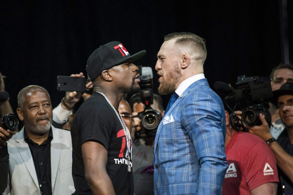 Floyd Mayweather, left, and Conor McGregor exchange harsh words during a promotional tour stop in Toronto on July 12, 2017, for their upcoming boxing match in Las Vegas. THE CANADIAN PRESS/Christopher Katsarov