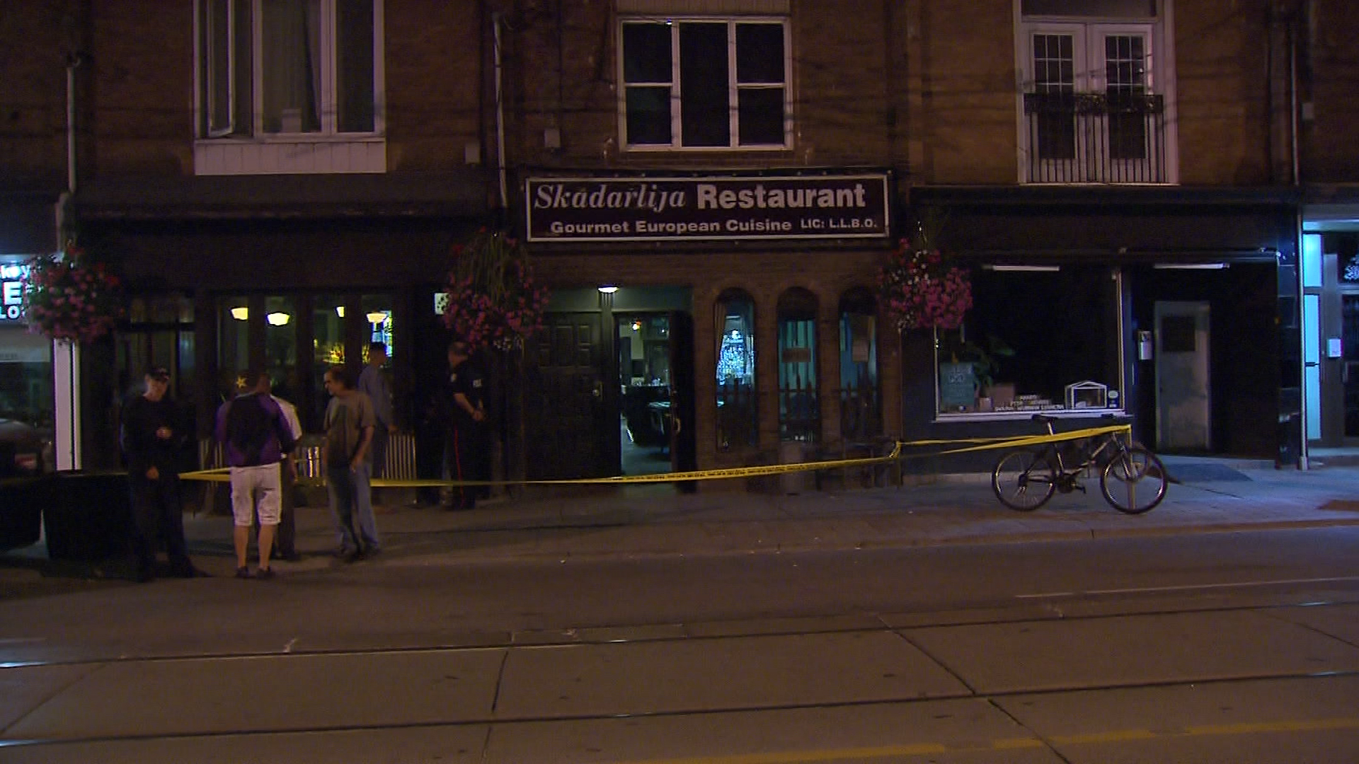 Toronto police investigate a shooting at a bar on Queen Street West near Sorauren Avenue on Sept. 12, 2017. CITYNEWS