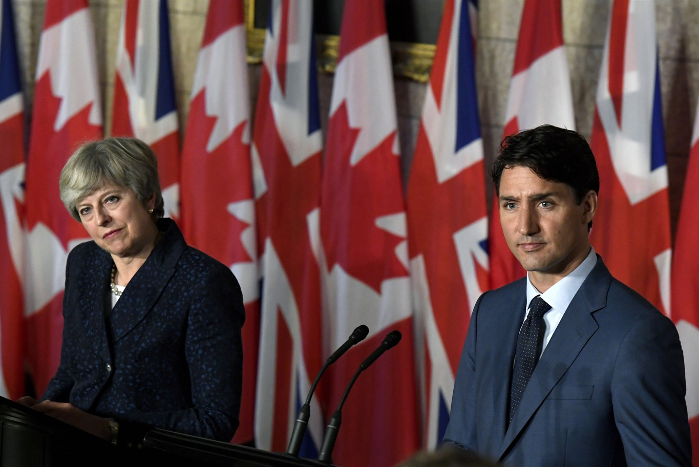 May hopes to boost Bombardier on trade mission to Canada