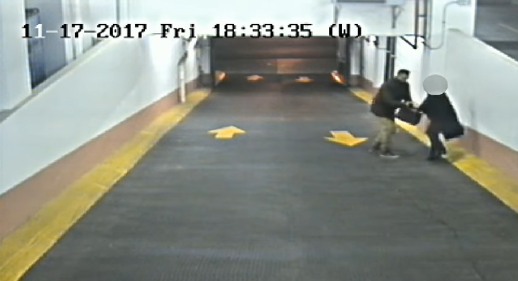 Security footage captures violent robbery attempt in parking garage