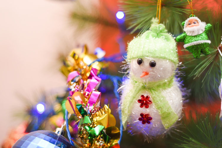 Christmas ornaments on a tree. GETTY IMAGES/Arijit Mondal