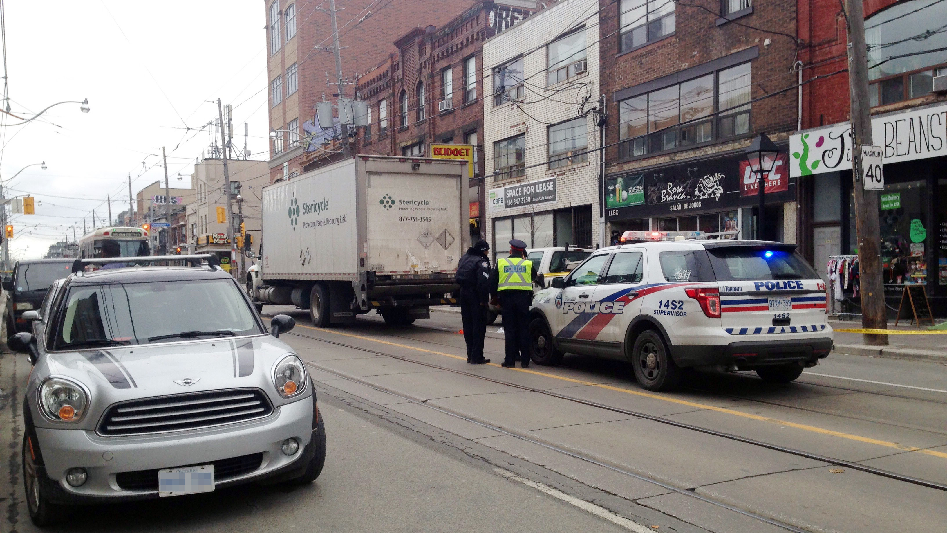 Police investigate after a cyclist was hit by a truck on College Street in Toronto's Little Italy neighbourhood on Dec. 20, 2017. CITYNEWS/Daniel Berry