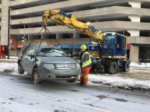 A vehicle is removed from inside the Queens Quay streetcar tunnel to Union station on New Year's Eve, 2017