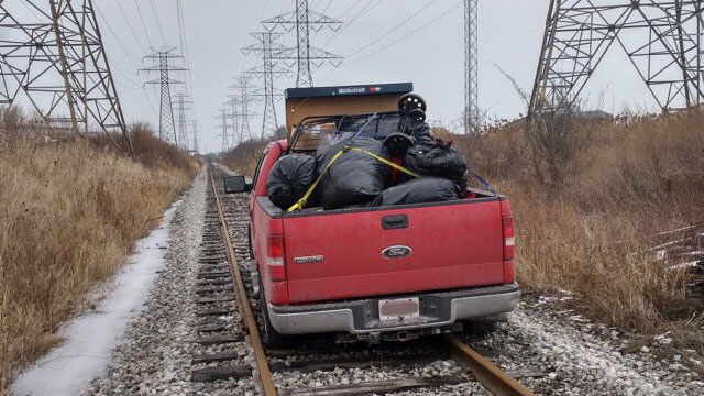 Suspects get stuck on train tracks while fleeing in stolen