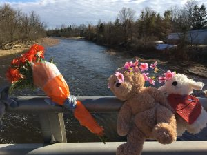 A makeshift memorial is seen on a bridge over the Grand River where a three-year-old went missing on Wednesday when he slipped from his mother's grip.