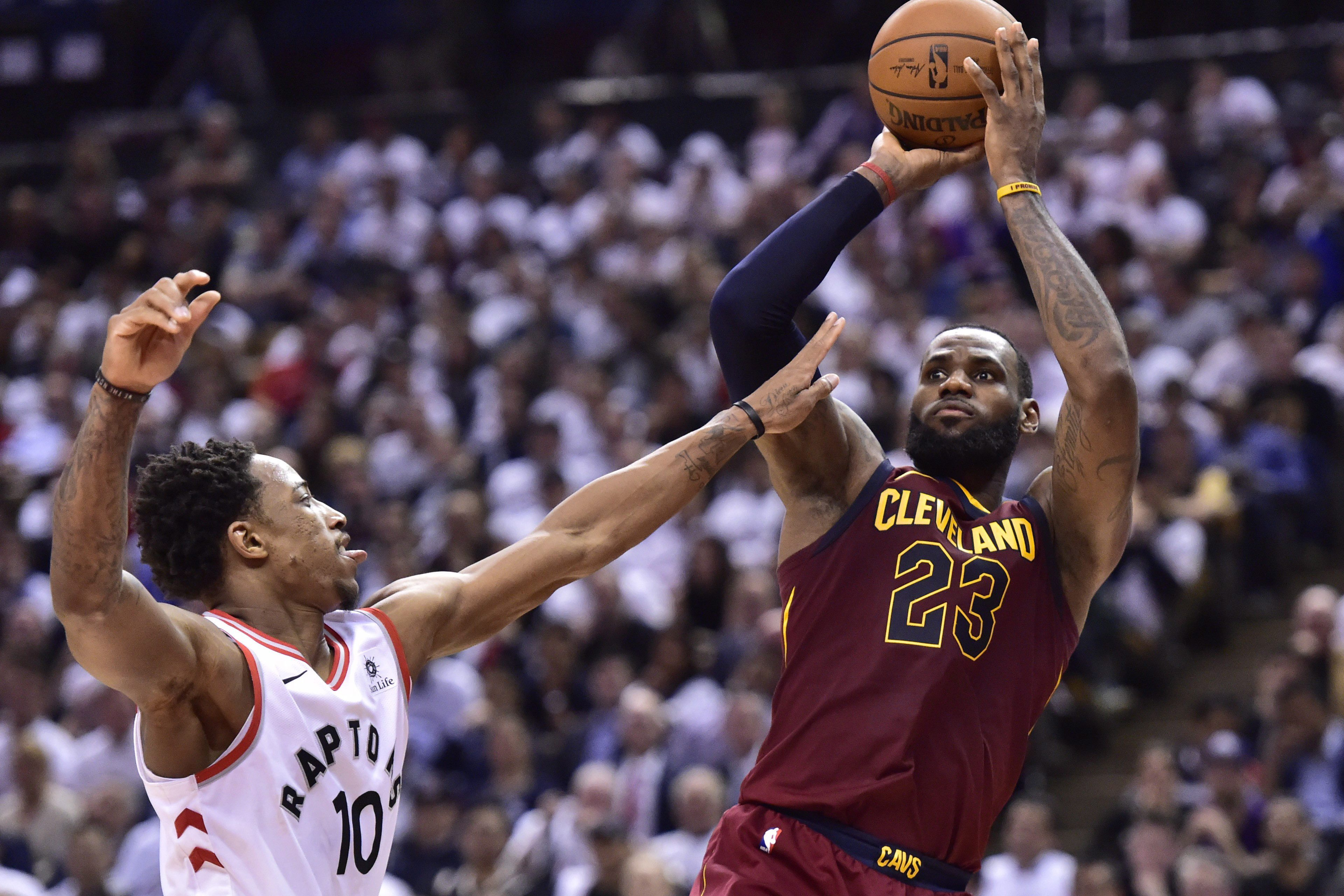 65feae01994 Cleveland Cavaliers forward LeBron James (23) scores over Toronto Raptors  guard DeMar DeRozan (10) during second half NBA playoff basketball action  in ...