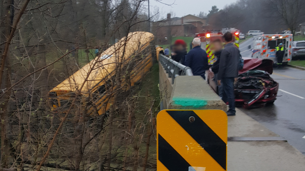 A school bus ended up in a ravine off a bridge in Bolton on May 4, 2018. Photo Credit: Lisa Saroli