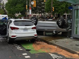 A car is seen on its roof after a crash at Jarvis and Wellesley streets in Toronto on May 19, 2018. CITYNEWS/Sean Toussaint