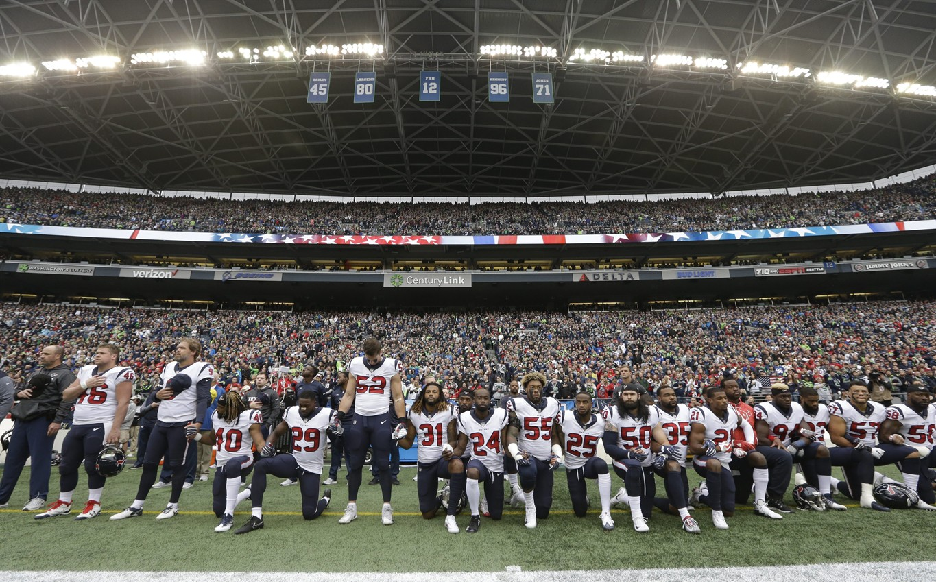National Football League mandates anthem respect: Stand up, or stay in the locker room