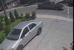 Police are looking for the driver of a grey Dodge Ram pick-up truck seen in this security photo in connection with a fatal hit-and-run