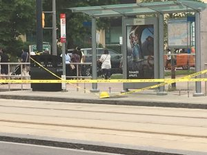 Police tape is seen blocking off a streetcar platform on Queens Quay and Lower Simcoe Street after smoke was seen emanating from a manhole cover in the area. CITYNEWS/Nitish Bissonauth