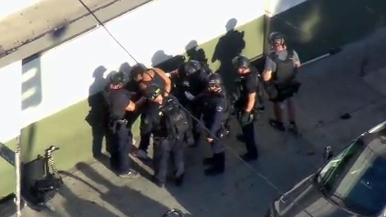 Gunman in LA supermarket standoff arrested for murder - CityNews Toronto