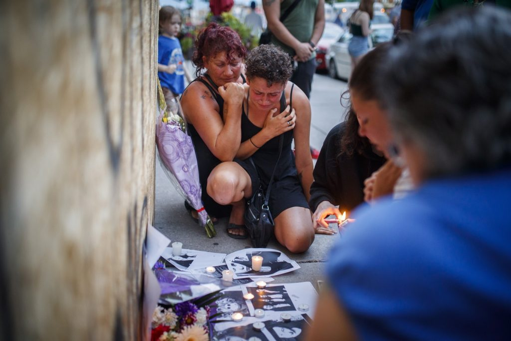 Friends of 18-year-old Danforth shooting victim Reese Fallon, Desirae Shapiro 19, right, and her mother Gina Shapiro, left, react after visiting a makeshift memorial remembering the victims of a shooting on Danforth Avenue on July 23, 2018. THE CANADIAN PRESS/Mark Blinch