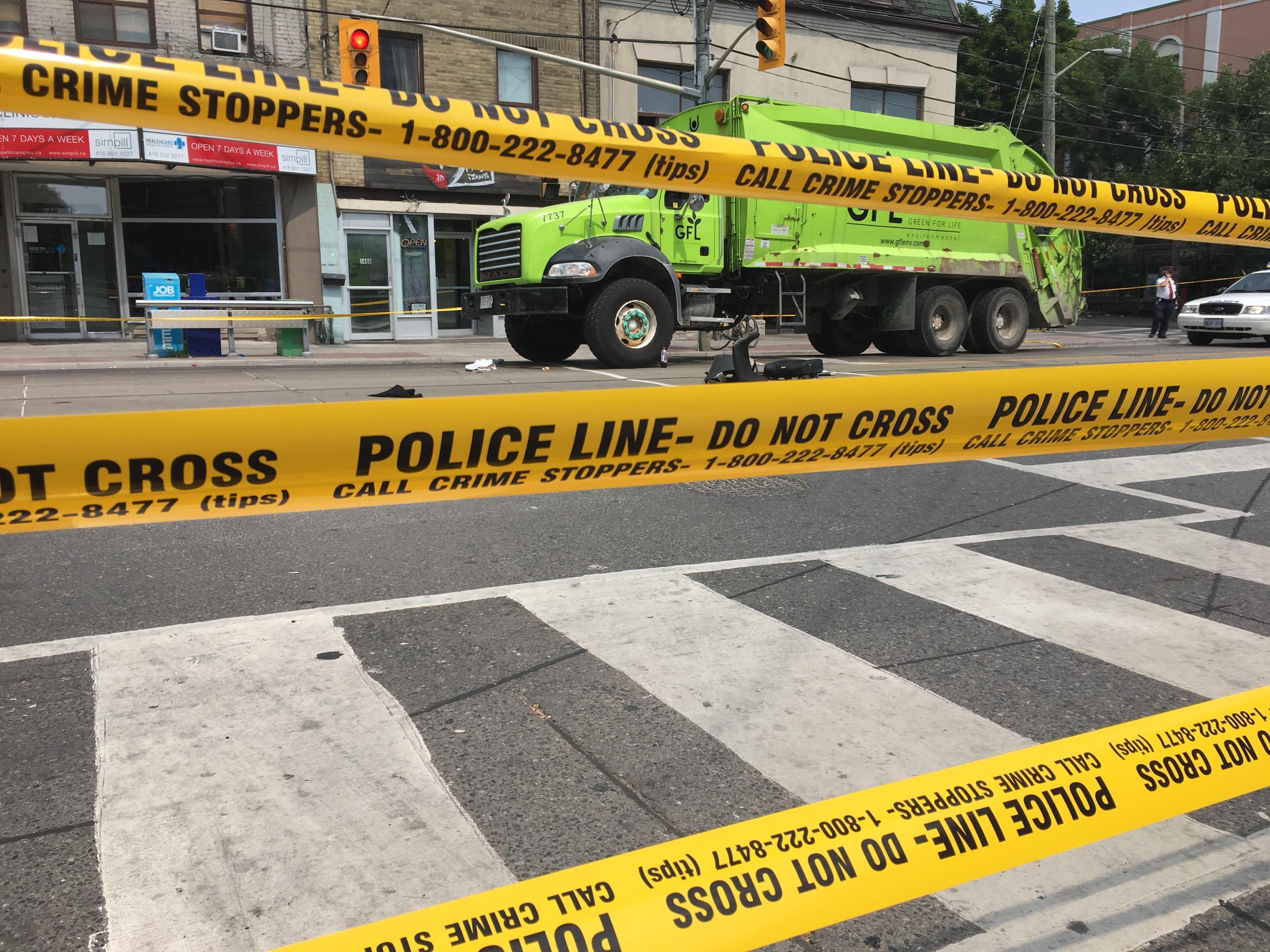 Pedestrian struck by garbage truck on Queen West