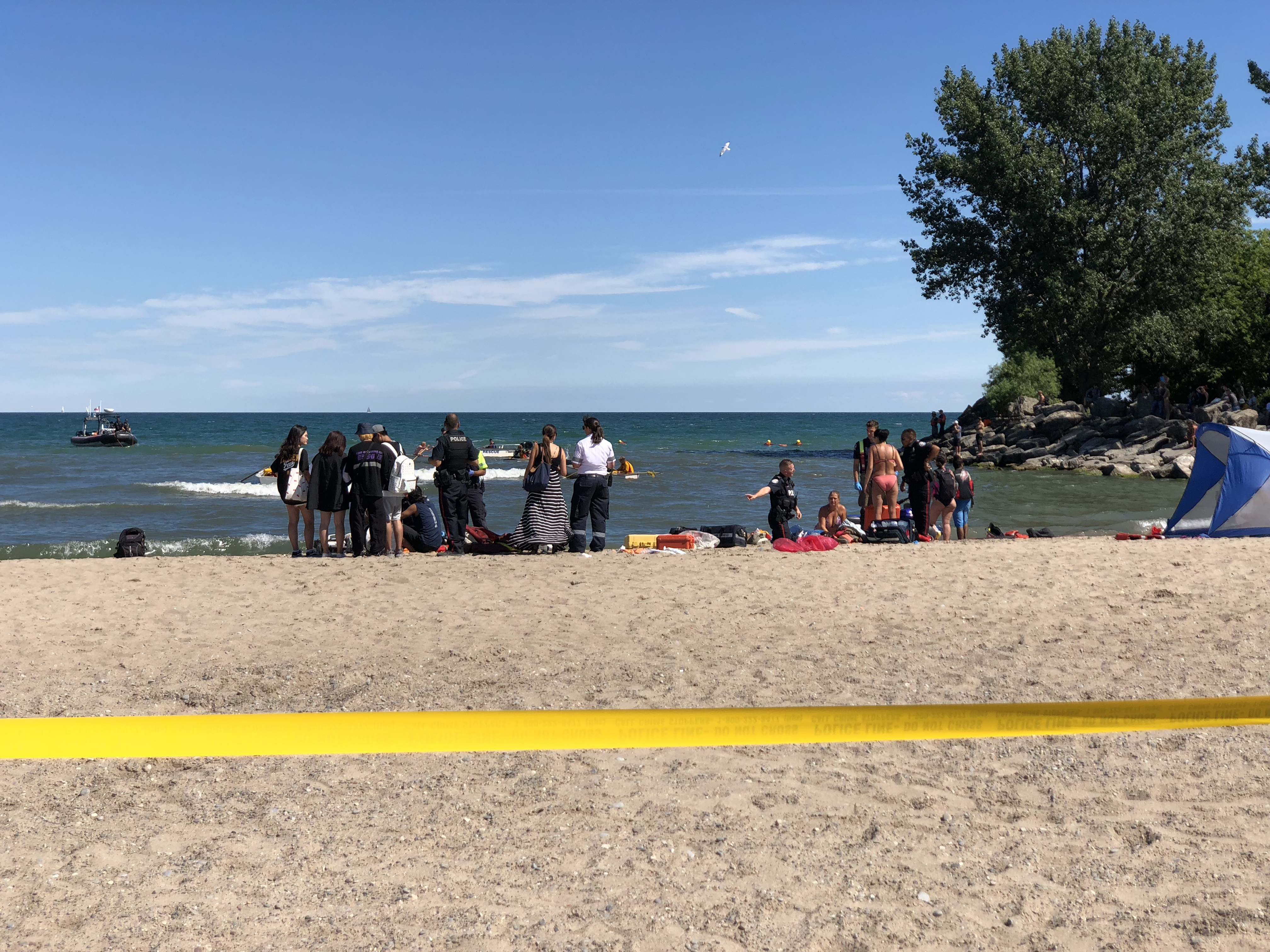 Police tape marks off an area of Woodbine Beach in Toronto during a water rescue on Aug. 10, 2018. CITYNEWS/John Hanley