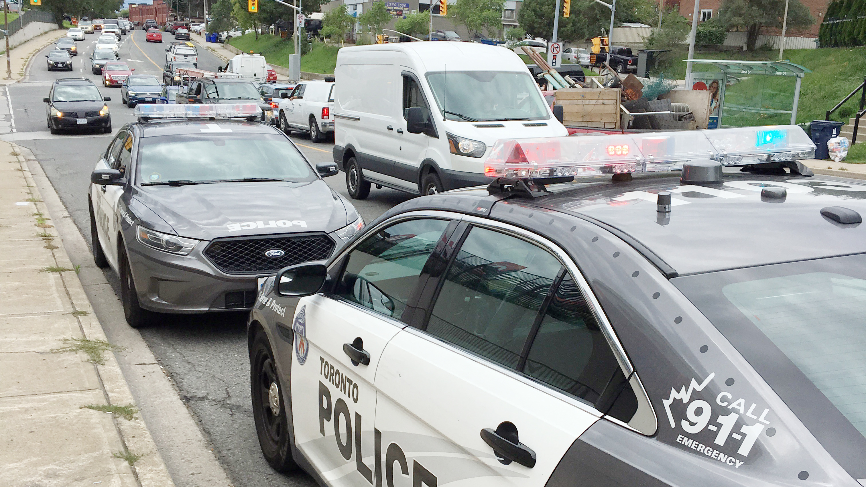 Police cruisers parked near the scene of a shooting near Jane Street and St. Clair Avenue West in Toronto on Aug. 29, 2018. CITYNEWS/Peter Dworschak