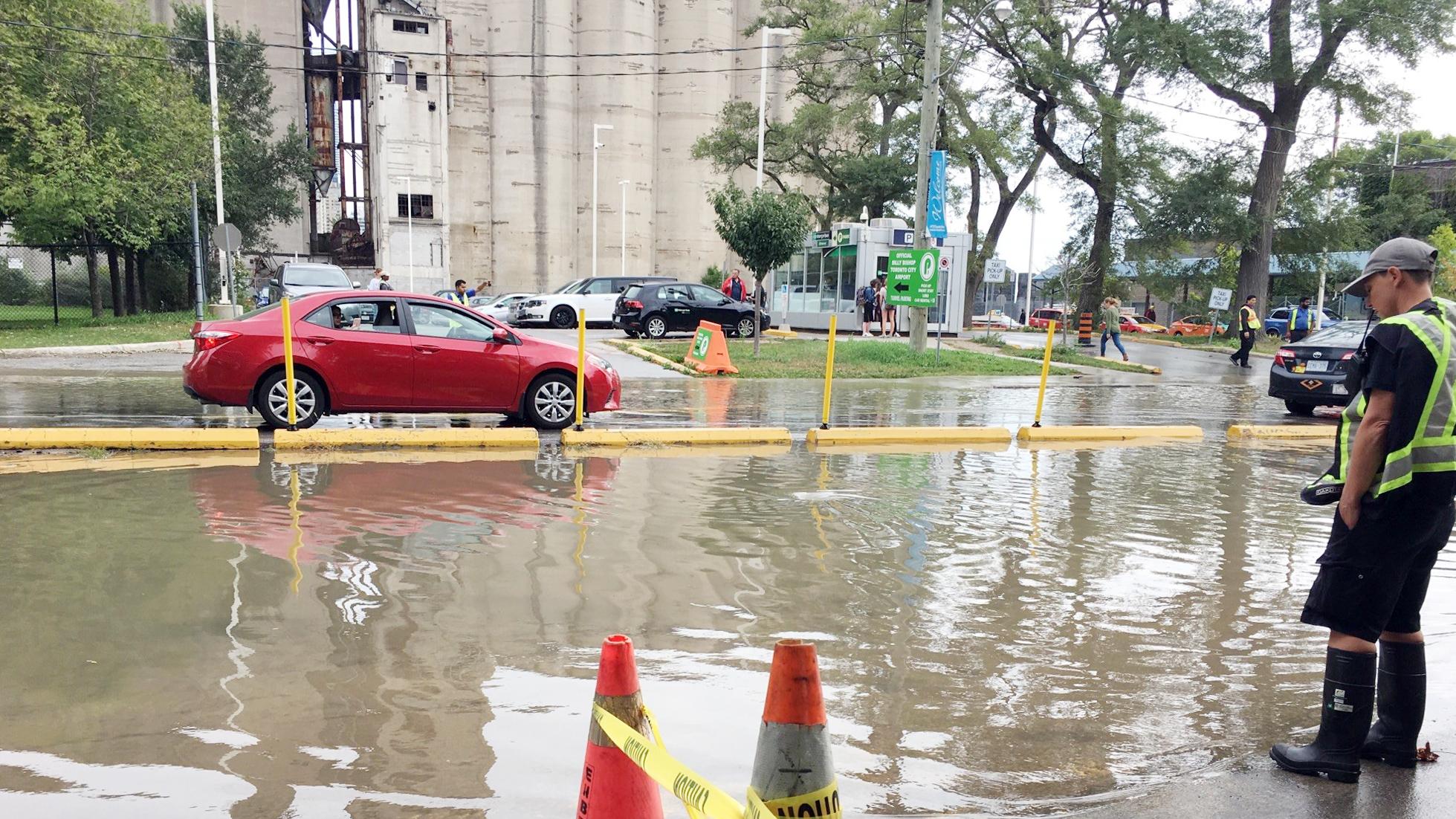 Water floods the street near Billy Bishop Toronto City Airport's mainland building after a watermain break on Sept. 20, 2018. CITYNEWS/Josef Fazio