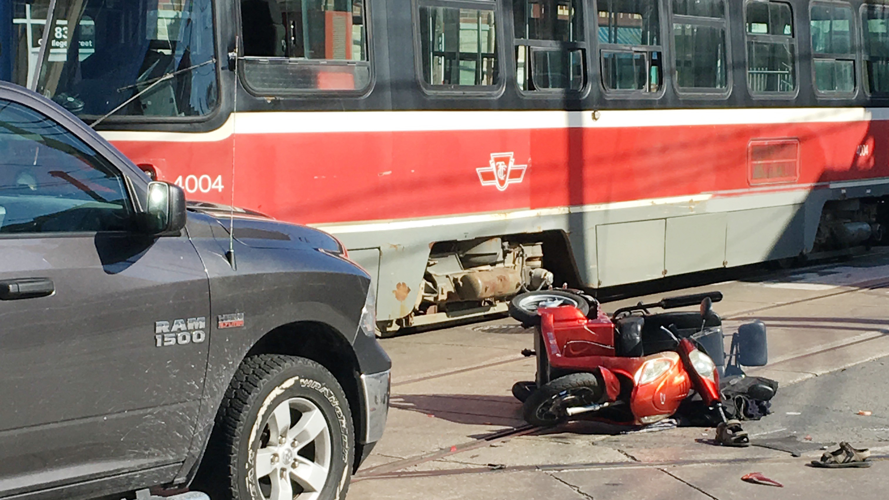 A man was critically injured when he was hit by a pickup truck while riding a mobility scooter at College Street and Ossington Avenue in Toronto on Oct. 10, 2018. CITYNEWS/Peter Dworschak