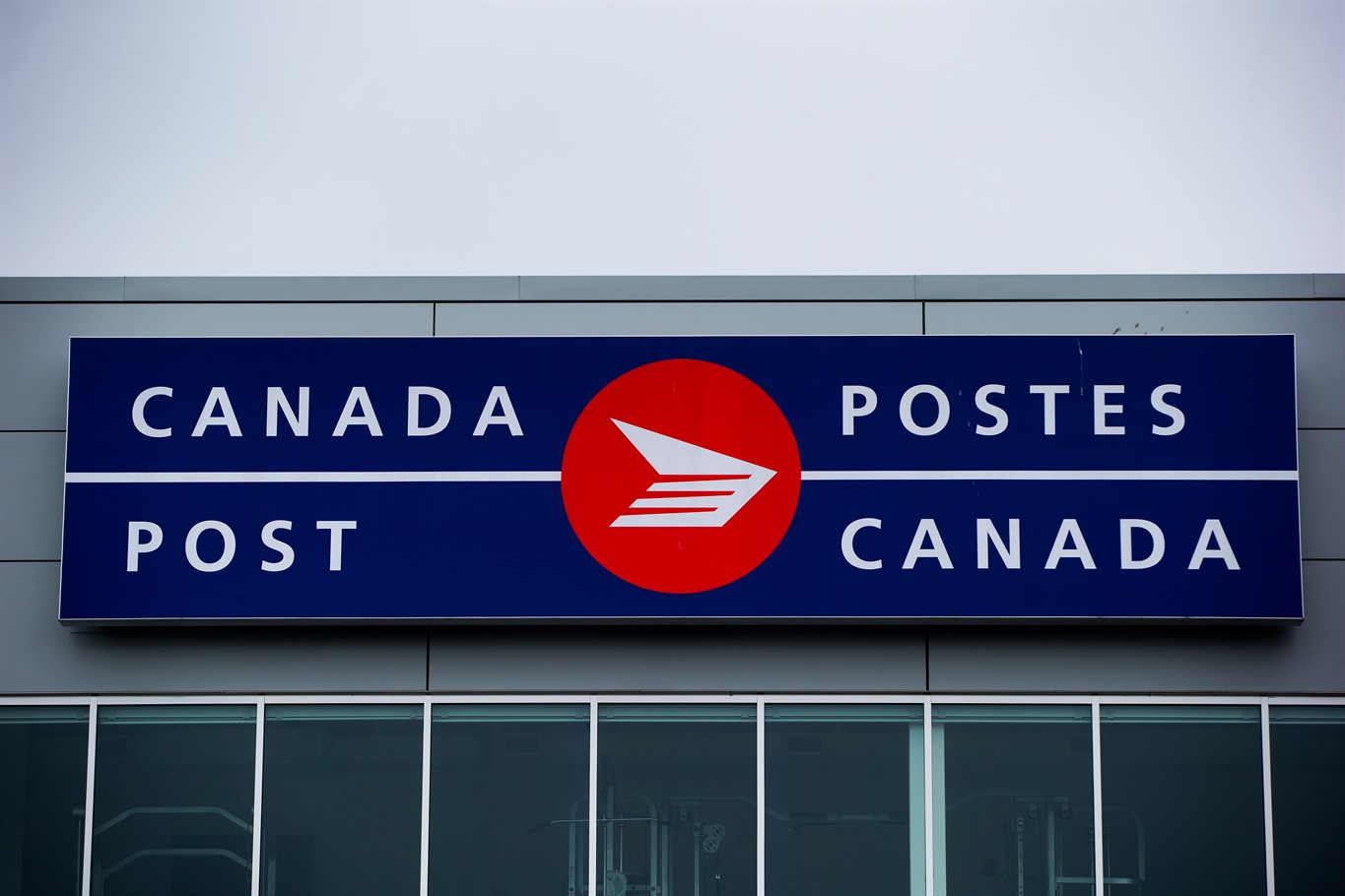 The Canada Post logo is seen on the outside the company's Pacific Processing Centre in Richmond B.C